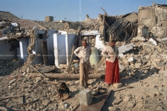 659-a-shot-of-couple-while-looking-at-damaged-houses-after-earthquake-in-image-88005500_20190716_161